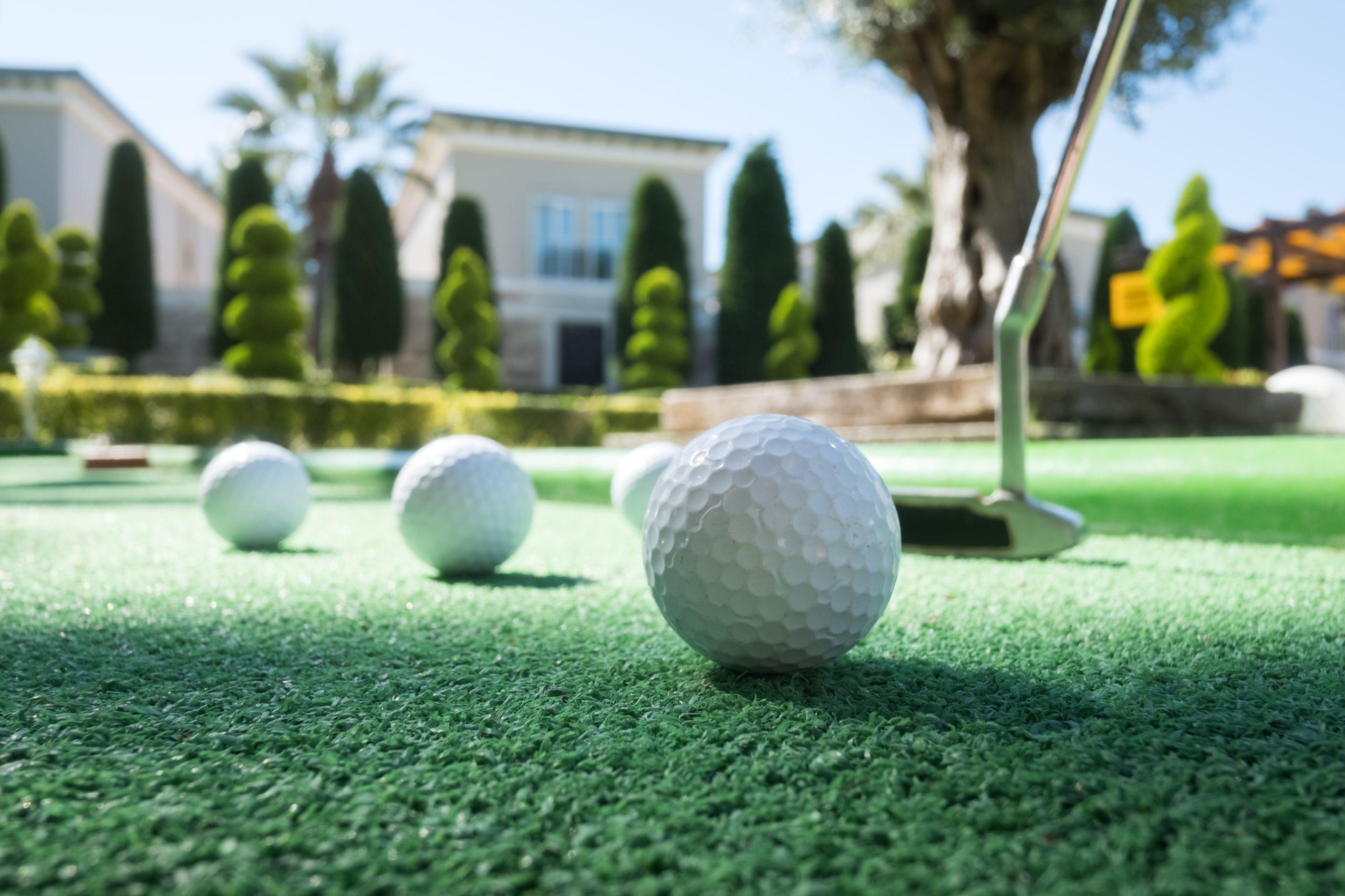 Mini golf scene with ball and club